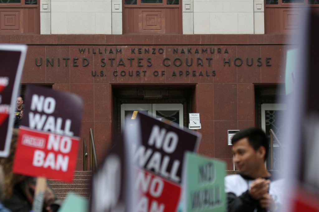 People protest President Donald Trump's travel ban outside of the U.S. Court of Appeals in Seattle, Washington in May. Photo by David Ryder/Reuters