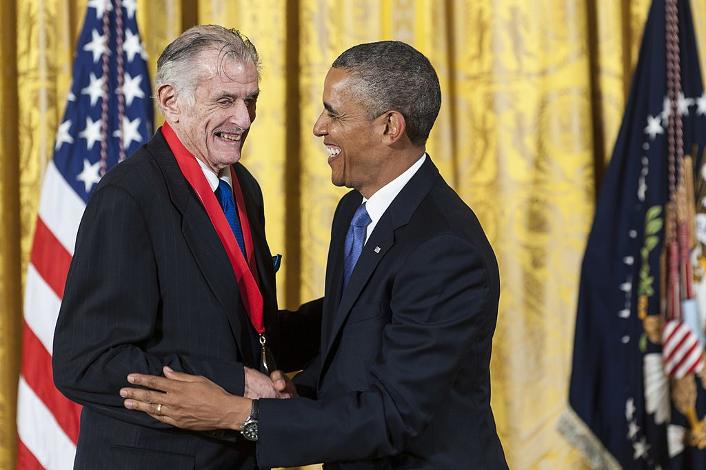 President Barack Obama  presents a 2012 National Humanities Medal to writer Frank Deford during a 2013 ceremony in the East Room of the White House in Washington, D.C. Photo by Pete Marovich/Getty Images.