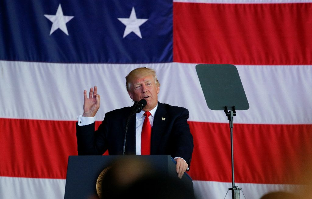 U.S. President Donald Trump delivers remarks to U.S. troops at the Naval Air Station Sigonella before returning to Washing...