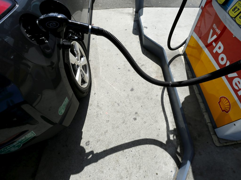 FILE PHOTO: A car is filled with gasoline at a gas station pump in Carlsbad, California. File photo by REUTERS/Mike Blake.