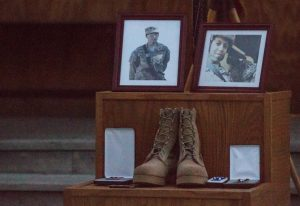 Photographs are displayed for a memorial ceremony held for U.S. Army Spc. Hilda Clayton, at Forward Operating Base Gamberi, Afghanistan. Clayton died while taking photographs of Afghan National Army soldiers as they conducted a live-fire training exercise. Photo taken in July 2013. Photo by Sgt. Richard Jones