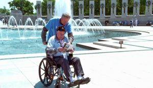 A veteran from Kentucky tours the World War II memorial in Washington, D.C., with his guardian on May 10. Photo by Larisa Epatko/PBS NewsHour