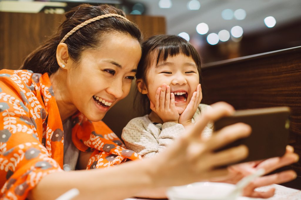 If parents are introducing young children to mobile technology, they should try and do it in a way that teaches the child to use the device as a tool rather than purely for entertainment. Photo by Tang Ming Tung