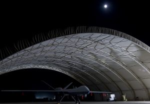 A U.S. Air Force MQ-9 Reaper unmanned aerial vehicle sits in a shelter at Joint Base Balad, Iraq in this October 15, 2008 USAF handout photo obtained by Reuters February 6, 2013. Larger and more powerful than the MQ-1 Predator, the Reaper can carry up to 3,750 pounds of laser-guided bombs and Hellfire missiles. REUTERS/U.S. Air Force/Tech. Sgt. Erik Gudmundson/Handout (UNITED STATES - Tags: MILITARY POLITICS) THIS IMAGE HAS BEEN SUPPLIED BY A THIRD PARTY. IT IS DISTRIBUTED, EXACTLY AS RECEIVED BY REUTERS, AS A SERVICE TO CLIENTS. FOR EDITORIAL USE ONLY. NOT FOR SALE FOR MARKETING OR ADVERTISING CAMPAIGNS - RTR3DF6W