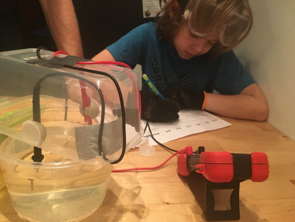 Declan taking down resistance measurements to convert to conductivity. Photo by Lauren Feeney