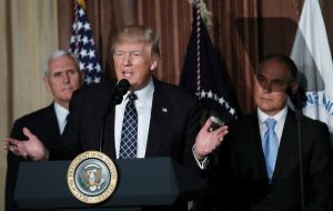 "President Donald Trump speaks between Vice President Mike Pence (L) and EPA Administrator Scott Pruitt prior to signing an executive order on ""energy independence,"" eliminating Obama-era climate change regulations, in March. Photo by REUTERS/Carlos Barria."