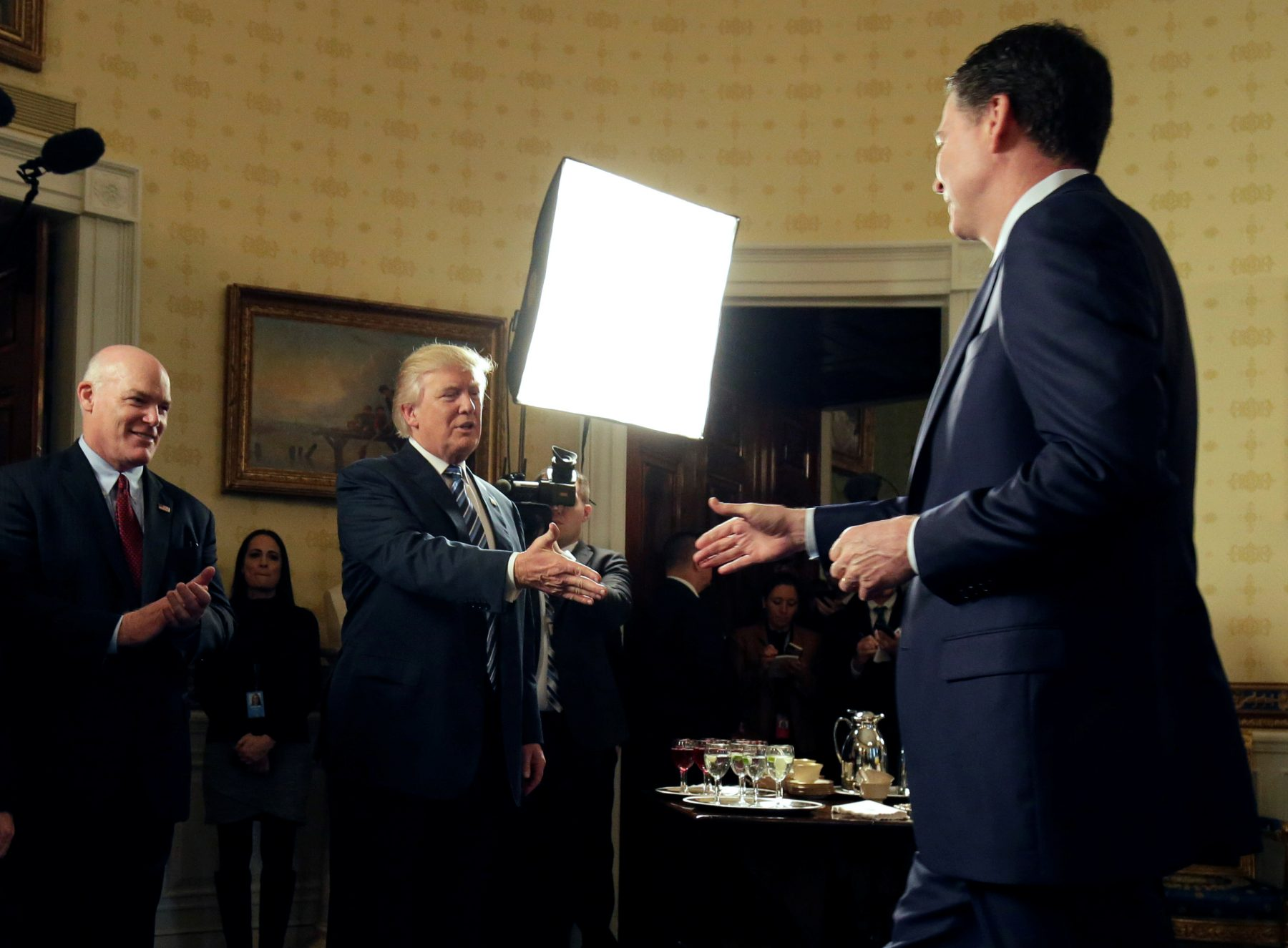 This January file photo shows President Donald Trump greeting Director of the FBI James Comey as Director of the Secret Service Joseph Clancy (L) watches during the Inaugural Law Enforcement Officers and First Responders Reception in the Blue Room of the White House. Photo by      REUTERS/Joshua Roberts.