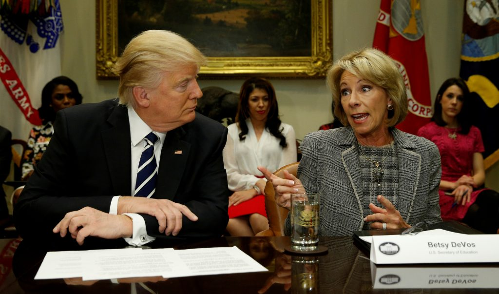 President Donald Trump listens to U.S. Secretary of Education Betsy DeVos speak at meeting with teachers and parents at the White House in Washington, U.S. on February 14, 2017.  REUTERS/Kevin Lamarque/File Photo - RTS160B3