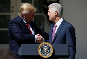 President Donald Trump shakes hands with Judge Neil Gorsuch after he was sworn in April 10 as an Associate Supreme Court in the Rose Garden of the White House in Washington, D.C. Photo by REUTERS/Joshua Roberts.