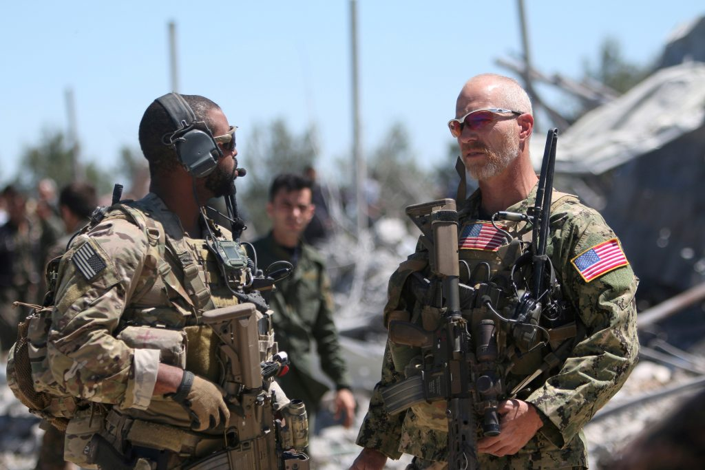 FILE PHOTO: U.S. forces are seen at the Kurdish People's Protection Units (YPG) headquarters after it was hit by Turkish airstrikes in Mount Karachok near Malikiya, Syria April 25, 2017. REUTERS/ Rodi Said/File Photo - RTS15YWB