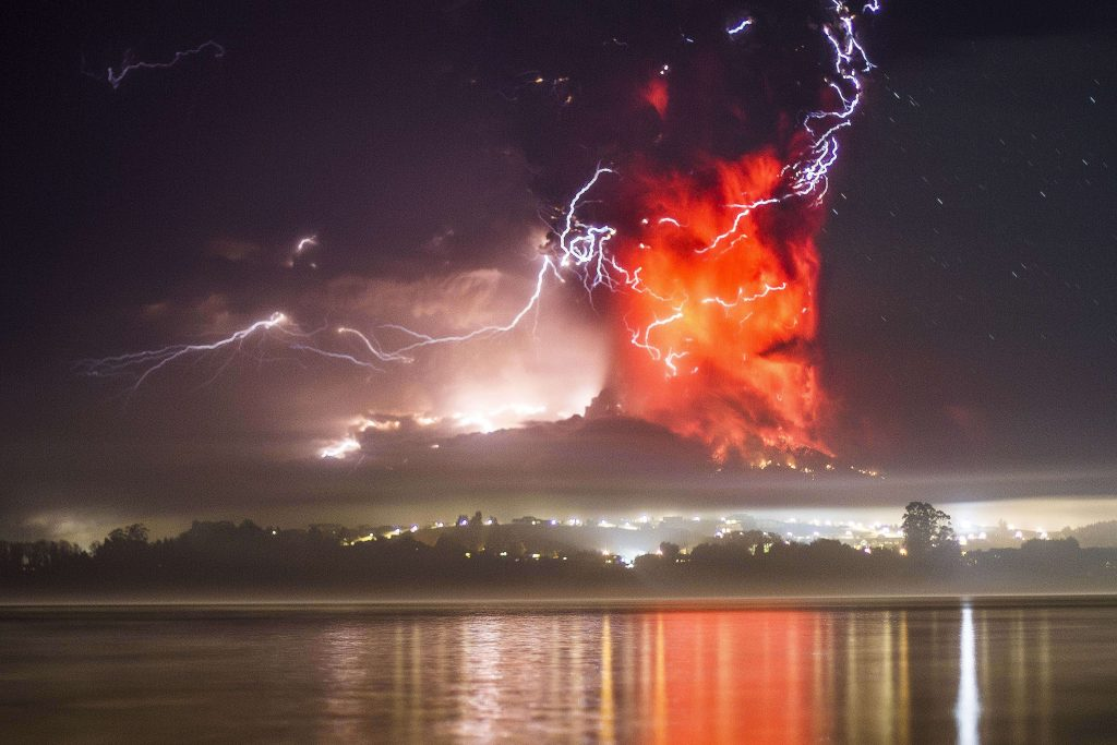 This view from Puerto Varas, southern Chile, shows a high column of ash and lava spewing from the Calbuco volcano, on April 23, 2015. Photo by David Cortes Serey/AFP/Getty Images
