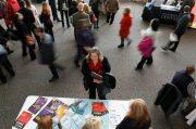 FILE PHOTO: A job seeker talks to an exhibitor at the Colorado Hospital Association health care career fair in Denver