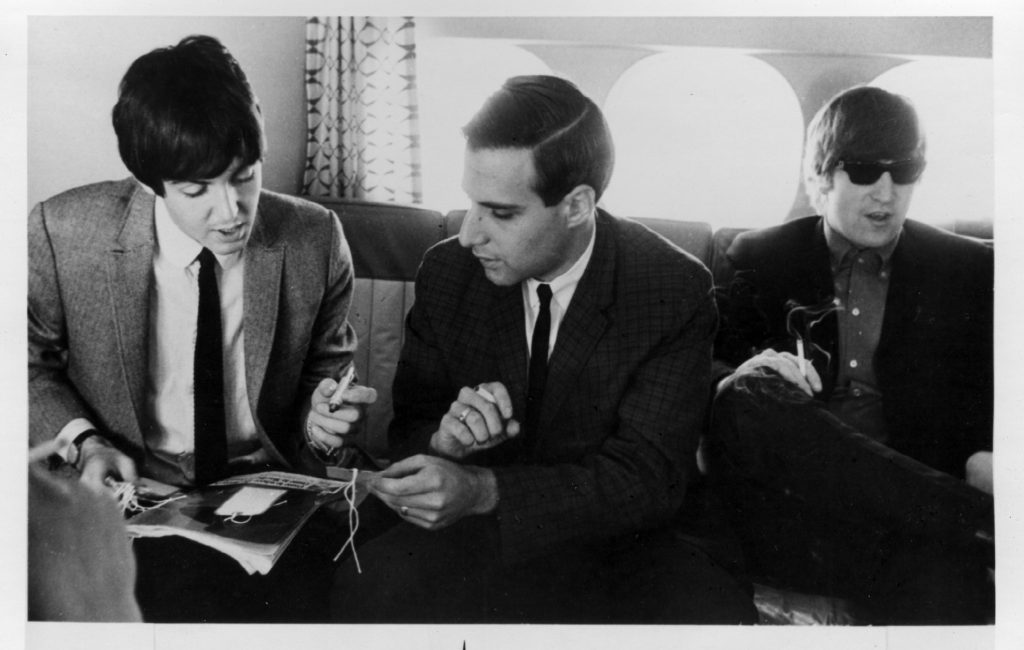 Kane sits down with John Lennon and Paul McCartney on the airplane during the band's first American tour. Photo courtesy of Larry Kane