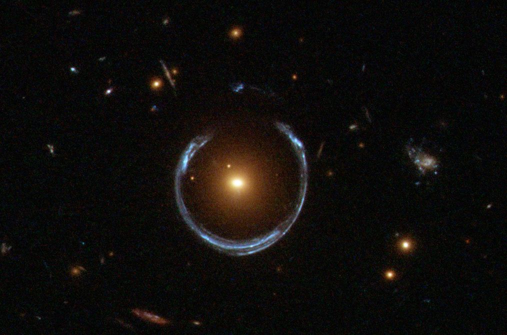 An example of gravitational lensing in action. Photo by NASA