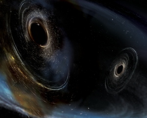 Artist's conception shows two merging black holes similar to those detected by LIGO. The black holes are spinning in a non-aligned fashion, which means they have different orientations relative to the overall orbital motion of the pair. LIGO found hints that at least one black hole in the system called GW170104 was non-aligned with its orbital motion before it merged with its partner. Image by LIGO/Caltech/MIT/Sonoma State (Aurore Simonnet)