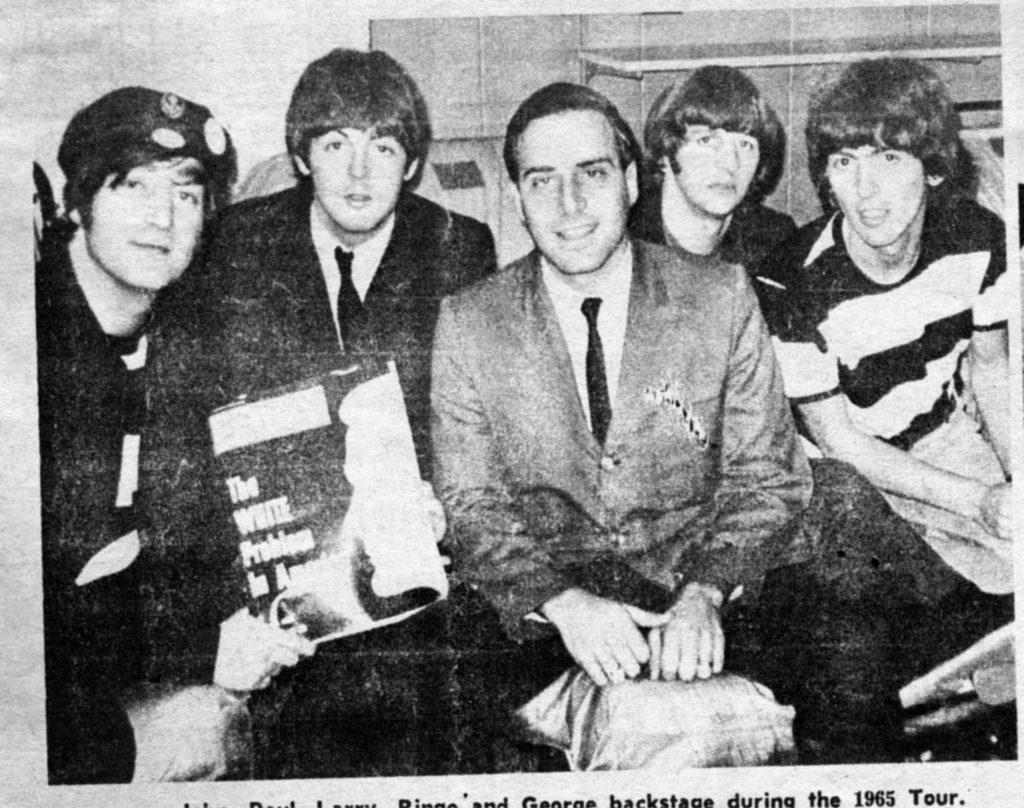 Kane poses with John Lennon, Paul McCartney, Ringo Starr and George Harrison with the cover of Ebony Magazine. Photo courtesy of Larry Kane