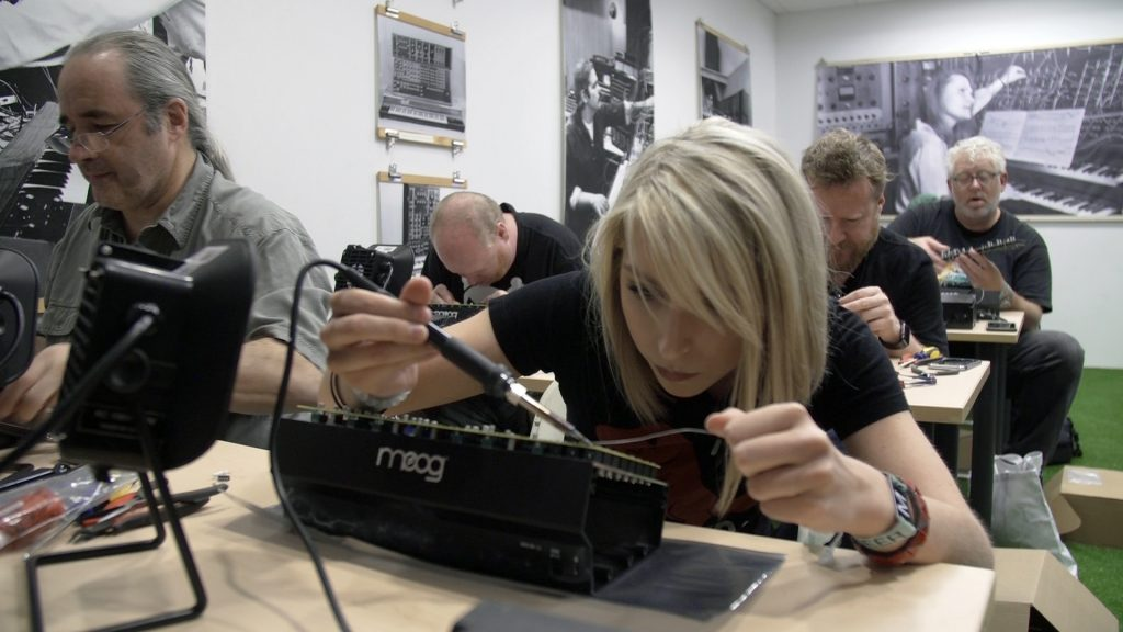 """Mack Bartsch builds a """"drummer from another mother"""" synthesizer as part of an engineering class at Moogfest, a technology and music festival in Durham, North Carolina. Photo by Andrew Bossone"""