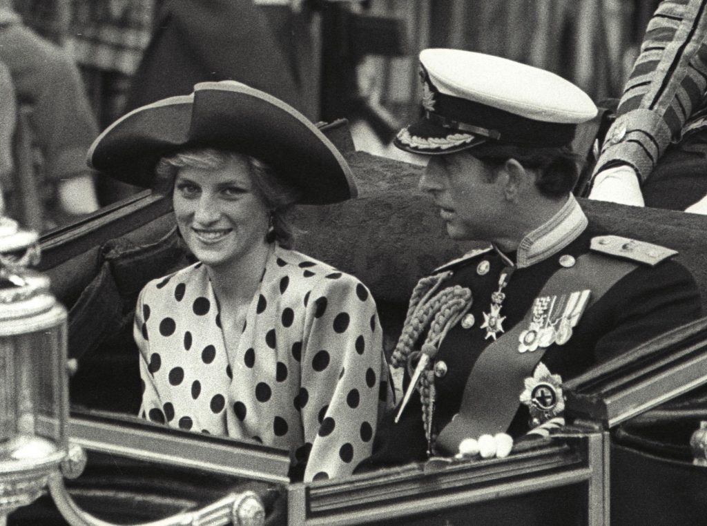 Prince Charles and Princess Diana ride in an open carriage from Buckingham Palace to Westminster Abbey on July 23, 1986 for the royal wedding of the Duke of York and Sarah Ferguson in London. REUTERS/Uli Michel - RTR1KFGR