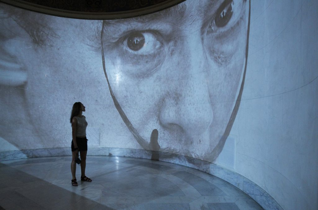 A visitor looks at a projection of a picture of Salvador Dali during a presentation of a 2011 exhibition of his work at Moscow's Pushkin Museum. Photo by Sergei Karpukhin/Reuters