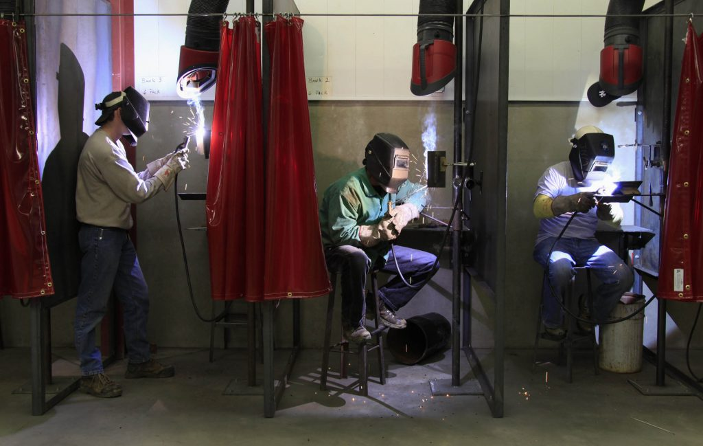 First year Ironworker apprentices (L-R) Ian Welshhans, Daniel Truax and Jason Taylor practice their welding skills during ...