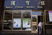 Woman enters branch of Abacus Federal Savings Bank on Bowery Street in New York