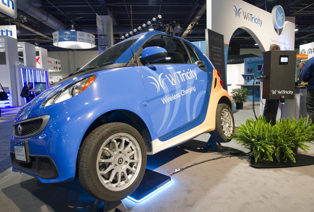 A WiTricity wireless car charger is shown under an electric car during the 2015 International Consumer Electronics Show (CES) in Las Vegas, Nevada January 6, 2015. Photo by Steve Marcus/REUTERS