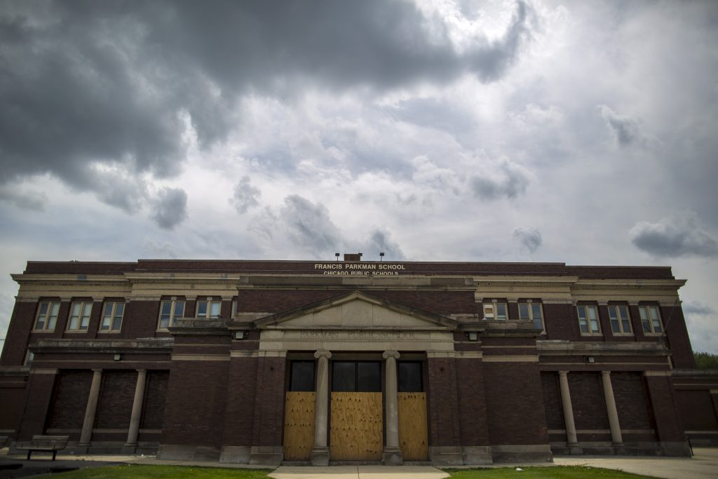 The entrance to Francis Parkman School is boarded up in Chicago, Illinois, May 8, 2015. Forty-nine elementary schools were targeted by the country's largest mass closing in 2013, and most are still empty two years later. Under-enrollment and low resources were cited by school board officials for the closures, which mainly affected poorer African-American and Latino neighborhoods. The shuttered buildings have become a vivid symbol of the fight over Chicago Mayor Rahm Emanuel's sweeping drive to reform education and tackle a projected $1.1 billion education budget deficit. Picture taken May 8, 2015. To match Feature USA-CHICAGO/EDUCATION REUTERS/Jim Young - RTR4YMRR