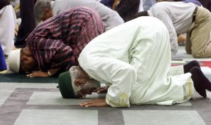 File photo of Muslims praying at an Islamic Center by Jeff Christensen/Reuters