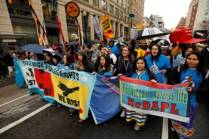 Members of the Standing Rock Sioux Nation and Indigenous leaders participate in a protest march and rally in opposition to the Dakota Access and Keystone XL pipelines in D.C. Photo by Kevin Lamarque/Reuters