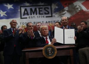 U.S. President Donald Trump signs an executive order on the establishment of office of trade and manufacturing policy during a tour at The Ames Companies in Harrisburg, Pennsylvania, U.S. April 29, 2017. REUTERS/Carlos Barria - RTS14I1F