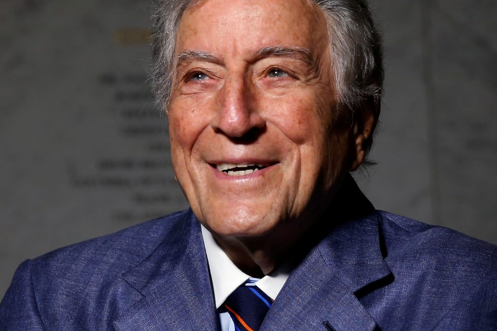 Singer and artist Tony Bennett poses for a portrait before an opening of his art exhibition in the Manhattan borough of New York. Photo by Carlo Allegri/Reuters