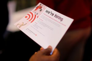 "FILE PHOTO: A job seeker holds a ""We're Hiring"" card while talking to a representative from Target at a City of Boston Neighborhood Career Fair on May Day in Boston, Massachusetts, U.S., May 1, 2017. REUTERS/Brian Snyder/File Photo GLOBAL BUSINESS WEEK AHEAD - SEARCH GLOBAL BUSINESS 8 MAY FOR ALL IMAGES - RTS15LSB"