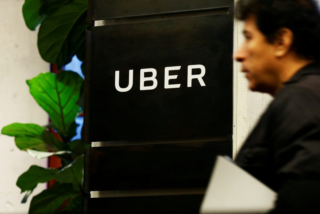 FILE PHOTO: A man exits the Uber offices in Queens, New York, U.S., February 2, 2017. REUTERS/Brendan McDermid/File Photo ...