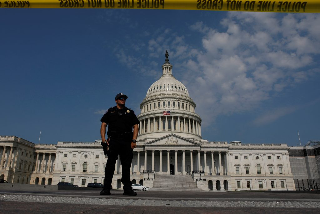 U.S. Capitol Police keep watch on Capitol Hill following a shooting in nearby Alexandria, in Washington, U.S., June 14, 2017. REUTERS/Aaron P. Bernstein - RTS172IQ