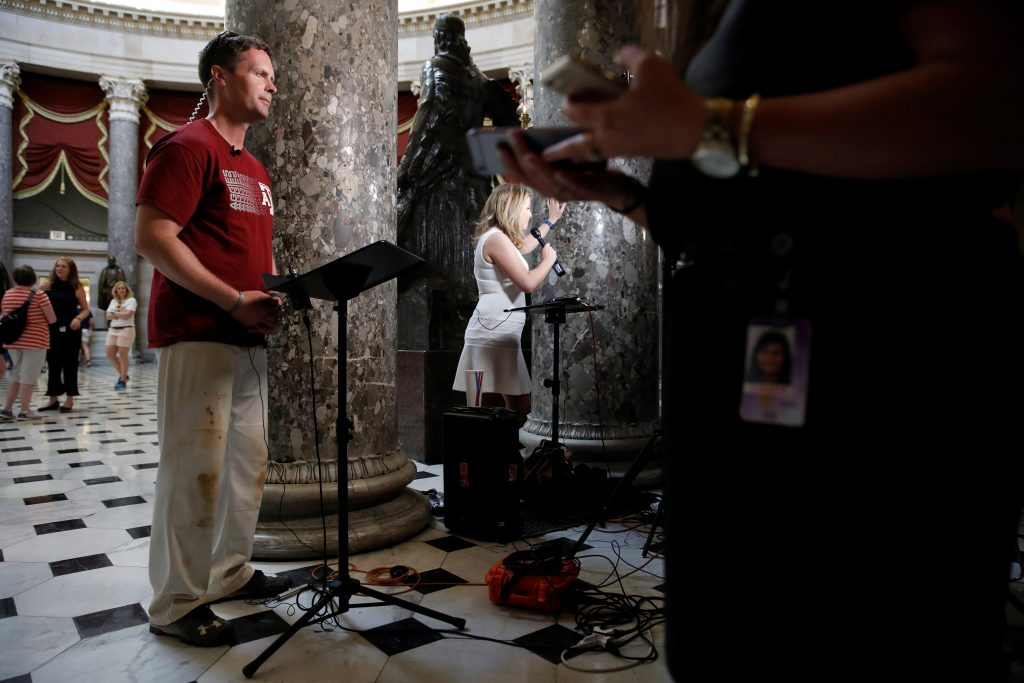 Rep. Rodney Davis (R-IL), catcher on the Republican Congressional Baseball Team, speaks with the media at the U.S. Capitol Building in Washington, U.S., June 14, 2017. REUTERS/Aaron P. Bernstein - RTS172QX