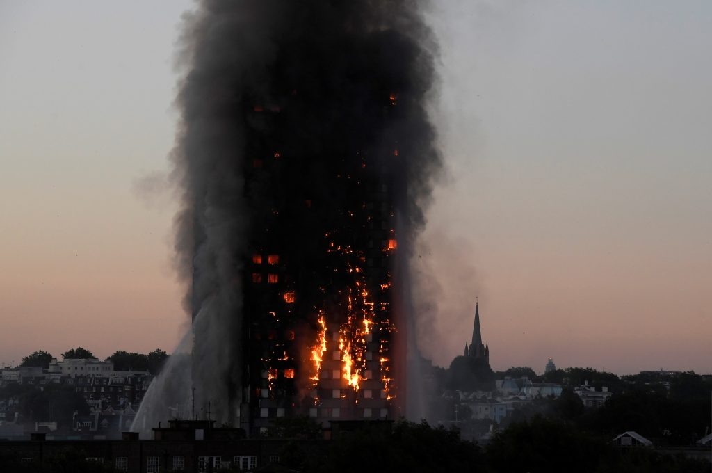 Flames and smoke billow from the Grenfell Tower apartments in West London on June 14. Photo by Toby Melville/Reuters