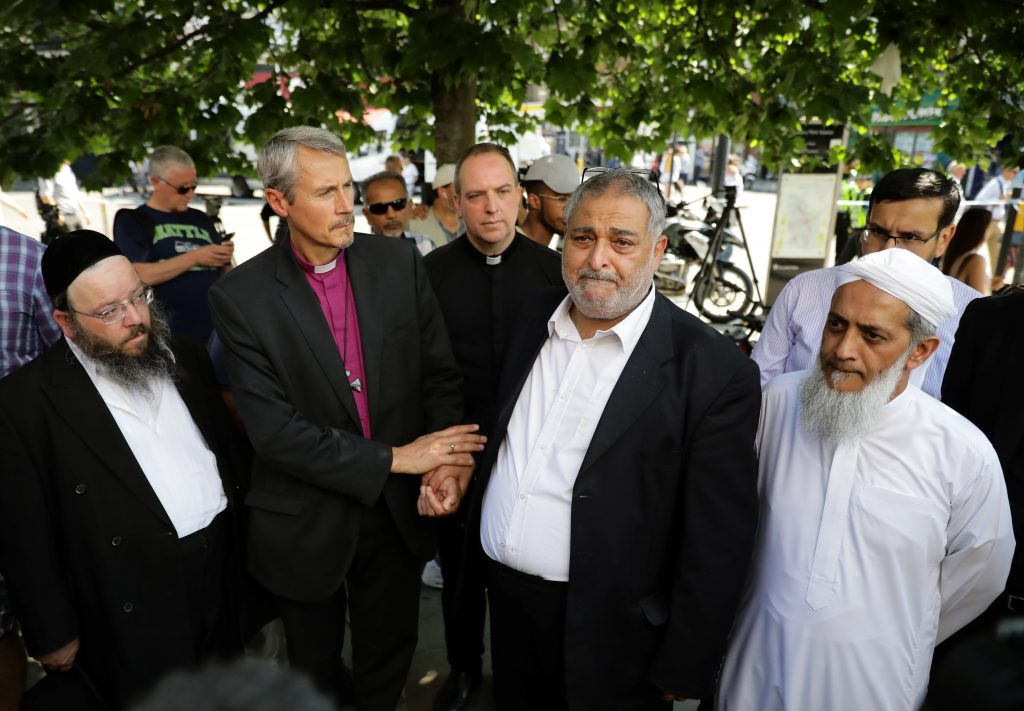 Local faith leaders stand together as they pose for photographers, near Finsbury Park Mosque, in a show of friendship following the attack outside the mosque, in London, Britain June 19, 2017.  REUTERS/Kevin Coombs - RTS17O4P
