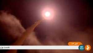 A still image taken from footage shot on June 18, 2017, and broadcast on Iranian Television IRINN, purports to show missiles being fired from Iran into eastern Syria. Image by IRINN via Reuters