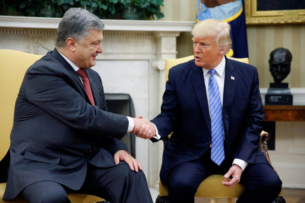 President Donald Trump (right) shakes hands with Ukraine's President Petro Poroshenko in the Oval Office at the White Hous...