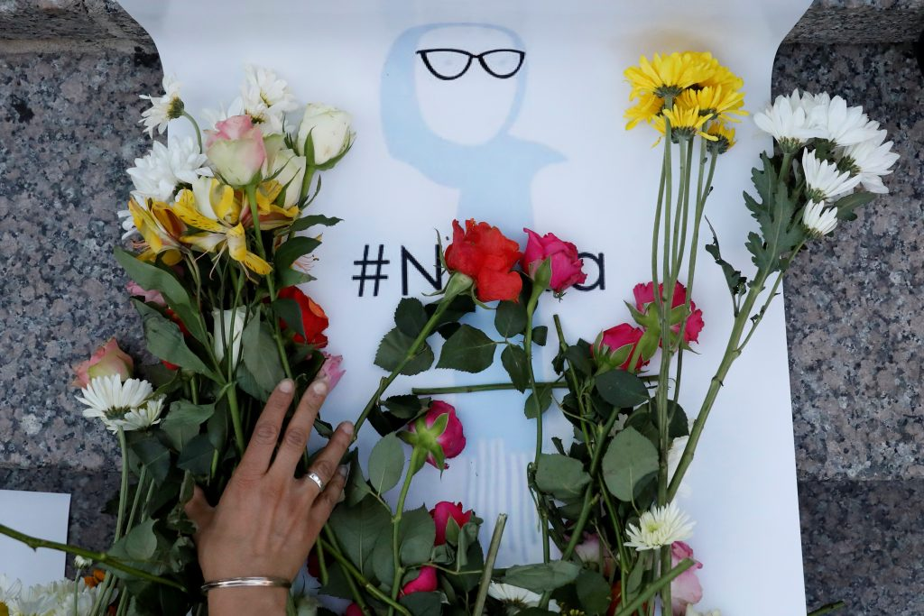 An attendee leaves flowers for Nabra Hassanen, a teenage Muslim girl killed by a bat-wielding motorist near a Virginia mosque, during a vigil in New York City. Photo by Brendan McDermid/Reuters