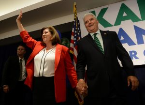 Karen Handel, Republican candidate for Georgia's 6th Congressional District, with husband Steve Handel at her side, waves to supporter after her acceptance speech at her election night party at the Hyatt Regency at Villa Christina in Atlanta, Georgia. Photo by Bita Honarvar/Reuters