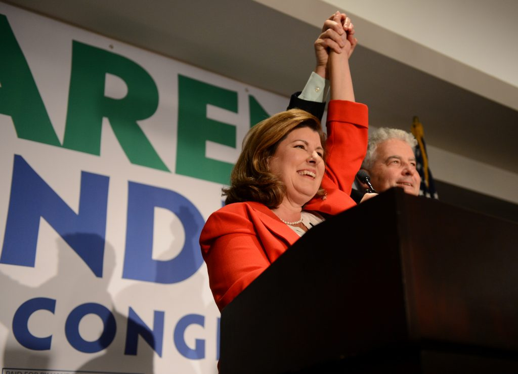 Karen Handel, Republican candidate for Georgia's 6th Congressional District, with husband Steve Handel at her side, gives her acceptance speech to supporters at her election night party at the Hyatt Regency at Villa Christina in Atlanta, Georgia. Photo by Bita Honarvar /Reuters