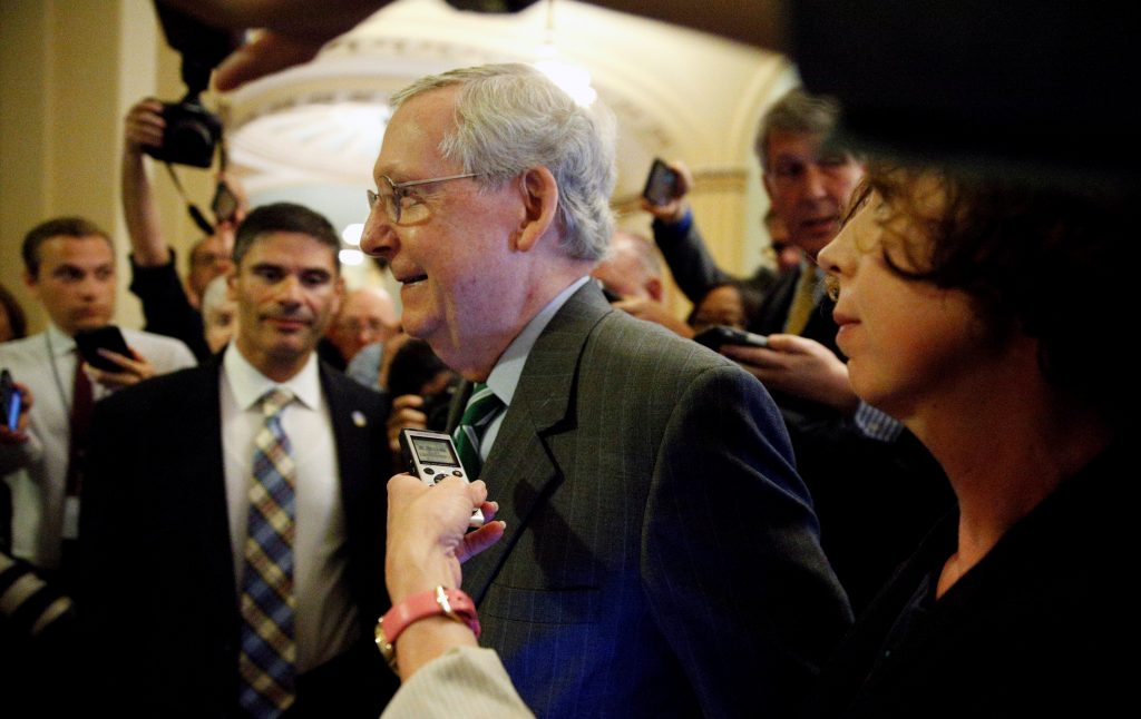 Senator Majority Leader Mitch McConnell is trailed by reporters as he walks to the Senate floor of the U.S. Capitol after unveiling a draft bill on healthcare in Washington, U.S., June 22, 2017. REUTERS/Kevin Lamarque - RTS188PK