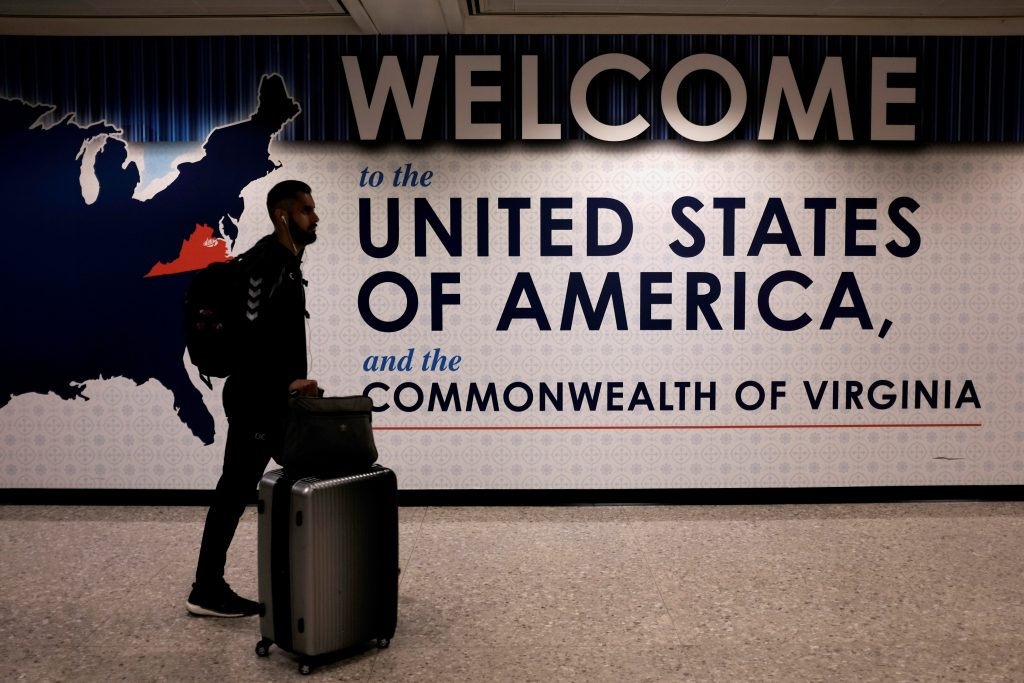 An international passenger arrives at Washington Dulles International Airport in Virginia after the Supreme Court granted parts of the Trump administration's emergency request to put its travel ban into effect later in the week pending further judicial review. Photo by James Lawler Duggan/Reuters