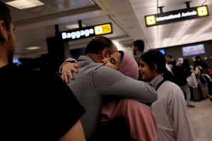 A Saudi family embraces as members arrive at Washington Dulles International Airport after the U.S. Supreme Court granted parts of the Trump administration's emergency request to put its travel ban into effect later in the week pending further judicial review, in Dulles, Virginia, U.S., June 26, 2017. REUTERS/James Lawler Duggan - RTS18QR3