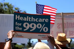 Protesters demonstrate the Republican healthcare bill outside Republican Congressman Darrell Issa's office in Vista, California, June 27, 2017. REUTERS/Mike Blake - RTS18VNT