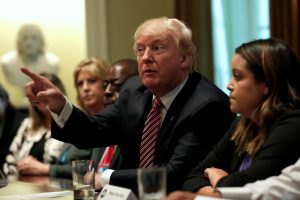 President Donald Trump talks to the media during his meeting with immigration crime victims at the White House in Washington, D.C. Photo by Yuri Gripas/Reuters