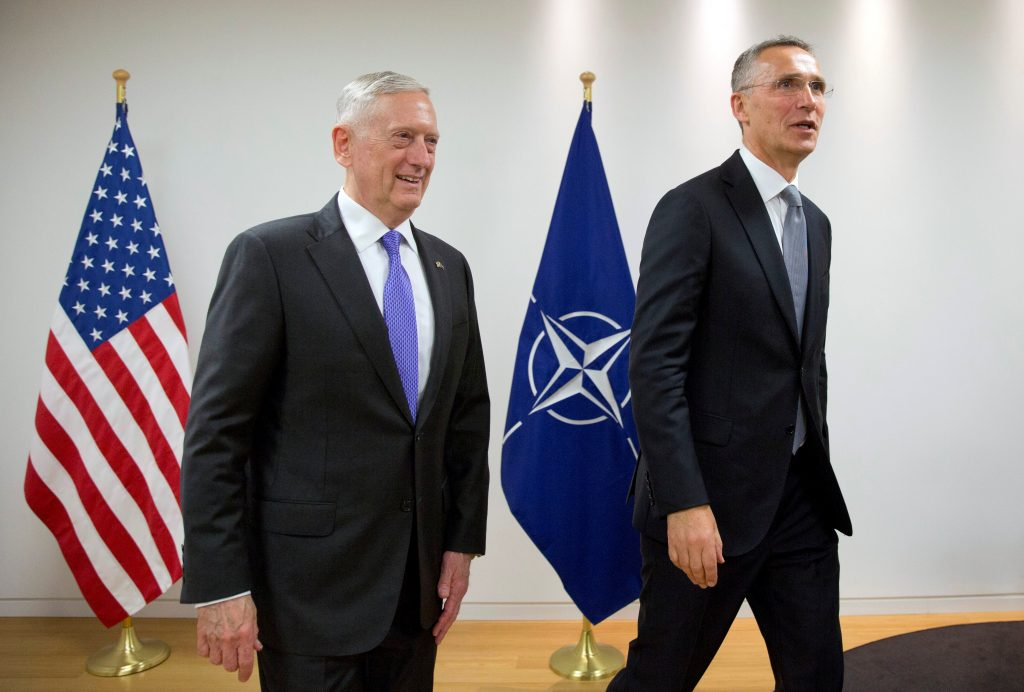 Secretary of Defense James Mattis and NATO Secretary-General Jens Stoltenberg pose during a NATO defence ministers meeting at the Alliance headquarters in Brussels, Belgium. Photo by Virginia Mayo/Pool/Reuters