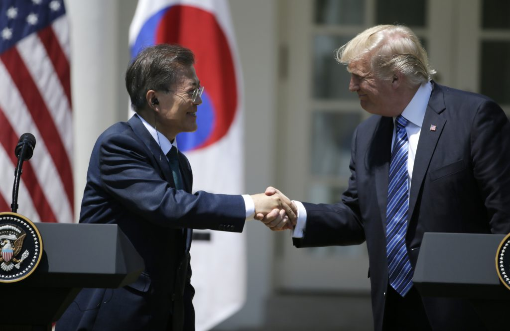 U.S. President Donald Trump  (R) greets South Korean President Moon Jae-in prior to delivering a joint statement from the Rose Garden of the White House in Washington, D.C.