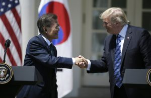 U.S. President Donald Trump greets South Korean President Moon Jae-in prior to delivering a joint statement from the Rose Garden of the White House on June 30, 2017. Photo by Jim Bourg/Reuters